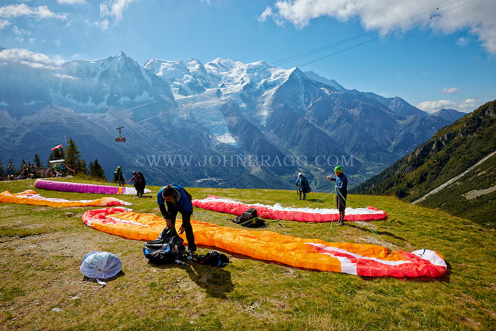 Paragliders preparing to take off from La Flégère, the French Alps with Mont Blanc in the background - Chamonix, France