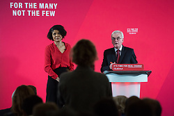 London, UK. 19 November, 2019. Shadow Chancellor John McDonnell, accompanied here by Chi Onwurah, Labour candidate for Newcastle Central, answers questions from the media following a major speech on the economy in Westminster. His speech promised that a Labour government would rewrite the rules of the economy through reforms to business regulation that would lay some of the foundations of a stakeholder economy and help workers to take back control.