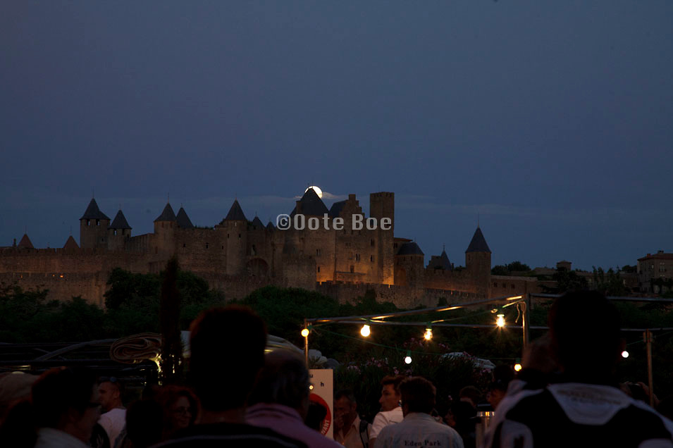 full moon coming up above the castle in La Cite Carcassonne on Bastille Day