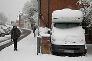 People in Moseley head out to enjoy the heavy snow fall on Sunday 10th December 2017 in Birmingham, United Kingdom. Deep snow arrived in much of the UK, closing roads and making driving treacherous, while many people simply enjoyed the weather.