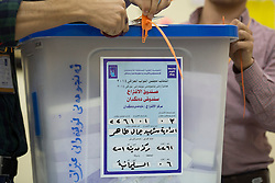 © Licensed to London News Pictures. 30/04/2014. Sulaimaniya, Iraq. Officials open a ballot box as they prepare to count he amount of votes cast at a school used as a polling station during the 2014 Iraqi parliamentary elections in Sulaimaniya, Iraqi-Kurdistan today (30/04/2014). <br /> <br /> The period leading up to the elections, the fourth held since the 2003 coalition forces invasion, has already seen polling stations in central Iraq hit by suicide bombers causing at least 27 deaths. Photo credit: Matt Cetti-Roberts/LNP