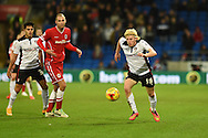 Rotherham's Ben Pringle ®  breaks away from Cardiff city's Matthew Connolly. Skybet football league championship match, Cardiff city v Rotherham Utd at the Cardiff city stadium in Cardiff, South Wales on Saturday 6th December 2014<br /> pic by Andrew Orchard, Andrew Orchard sports photography.