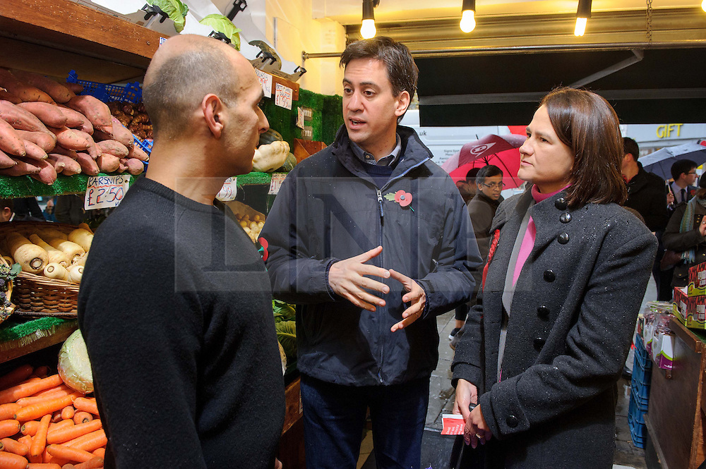 © Licensed to London News Pictures. 09/11/2013 London, UK. Labour Party leader Ed Miliband visits a green grocers in Crouch End, North London with Labour prospective parliamentary candidate for Hornsey and Wood Green, Catherine West during a visit to the constituency.<br /> Photo credit : Simon Jacobs/LNP