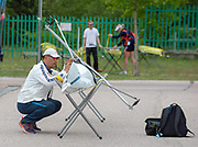 Plovdiv, Bulgaria, 9th May 2019, FISA, Rowing World Cup 1,  Coach, CHN, checks boat.<br /> [© Peter SPURRIER]