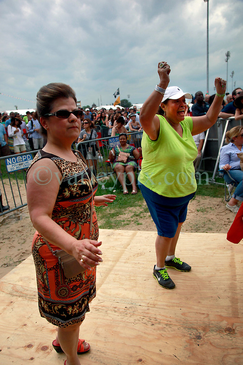 28 April 2013. New Orleans, Louisiana,  USA. .Faces in the crowd. Dancing at the New Orleans Jazz and Heritage Festival. .Photo; Charlie Varley.