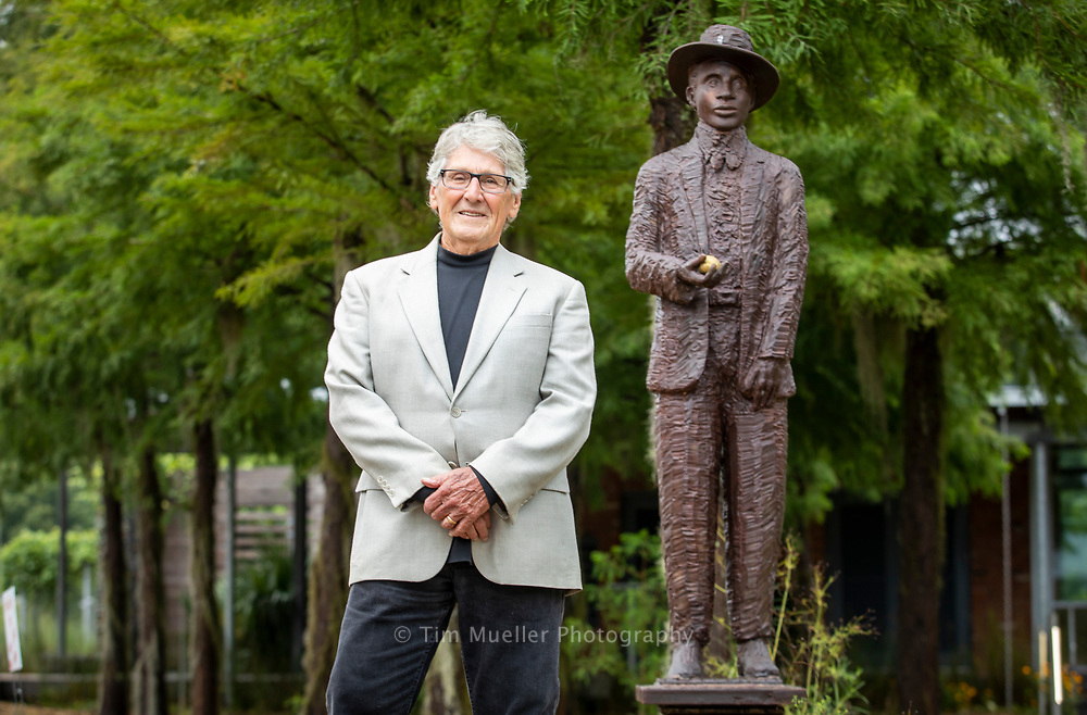 Darrell Bourque, who co-founded the Bring Amédé Home project, stands next to the statue of Amédé Ardoin located on the grounds of St. Landry Visitors Center. The statue, created by sculptor Russell Whiting, honors Ardoin who is considered one of Louisiana's most influential recording artists. The statue shows Ardoin with an outstretched hand holding a lemon, which Ardoin always carried to keep his voice strong.
