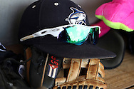 04 June 2016: Nova Southeastern's Julian Pino's glove and hat in the dugout. The Nova Southeastern University Sharks played the Millersville University Marauders in Game 14 of the 2016 NCAA Division II College World Series  at Coleman Field at the USA Baseball National Training Complex in Cary, North Carolina. Nova Southeastern won the game 8-6 and clinched the NCAA Division II Baseball Championship.