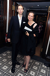 Photographer NICK KNIGHT and his wife CHARLOTTE at Vogue's Celebation of Fashion dinner held at The Albermarle, Brown's Hotel, Albermarle Street, London on 18th September 2008.