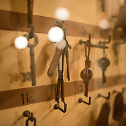 Keys hanging on key boards at the Churchill War Rooms in London. The museum, one of five branches of the Imerial War Museums, preserves the World War II underground command bunker used by British Prime Minister Winston Churchill. Its cramped quarters were constructed from a converting a storage basement in the Treasury Building in Whitehall, London. Being underground, and under an unusually sturdy building, the Cabinet War Rooms were afforded some protection from the bombs falling above during the Blitz.