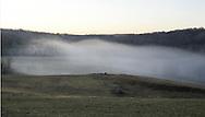 Fog rolls over a field near the Moodna Creek in Salisbury Mills on Friday, Jan. 11, 2008.