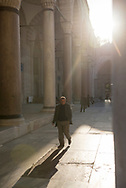 A man walks in the courtyard of the Süleymaniye Mosque in Istanbul, Turkey. The mosque was built between 1550 and 1557.
