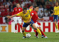 Photo: Chris Ratcliffe.<br /> Sweden v England. FIFA World Cup 2006. 20/06/2006.<br /> Kim Kallstrom of Sweden clashes with Frank Lampard of England.