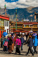 Tibetan pilgrims circumambulating through Barkhor Square and along The Barkhor Tibet (the route around the Jokhang Temple), Old Lhasa,  (Xizang), China.