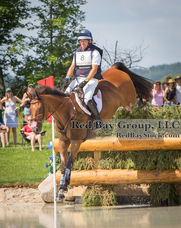 Phillip Dutton (USA) and Fernhill Fugitive at Caledon Equestrian Park Cross-Country Centre during the  Toronto 2015 Pan American Games in Caledon, Ontario, Canada.
