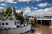 House boats moored near to Battersea Power Station, London.