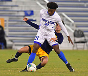 St. Louis University defender Daniel Moore controls the ball as University of Missouri - Kansas City player Aiden Cavanaugh tries to get to it from behind him. St. Louis University played the University of Missouri - Kansas City in men's soccer on February 3, 2021 at Robert Hermann Stadium on the SLU campus in St. Louis, MO.<br /> Tim Vizer/For the Post-Dispatch