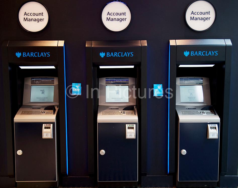 Three Account Manager banking machines.