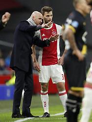 (L-R) coach Erik ten Hag of Ajax, Joel Veltman of Ajax during the Dutch Eredivisie match between Ajax Amsterdam and NAC Breda at the Amsterdam Arena on February 04, 2018 in Amsterdam, The Netherlands