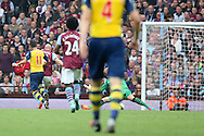 Mezut Ozil of Arsenal (11) scores his side's first goal. Barclays Premier league match, Aston Villa v Arsenal at Villa Park in Birmingham on Saturday 20th Sept 2014<br /> pic by Mark Hawkins, Andrew Orchard sports photography.