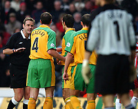 Photo. Javier Garcia<br />15/02/2003 Southampton v Norwich, FA Cup 5th Round, St. Mary's Stadium<br />Ref Graham Barber has to calm Norwich teammates Craig Fleming and Steen Nedergaard down after they fell out in the penalty area