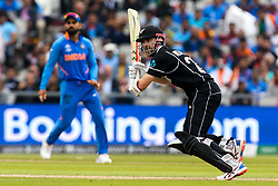 Kane Williamson of New Zealand bats as Virat Kohli of India looks on - Mandatory by-line: Robbie Stephenson/JMP - 09/07/2019 - CRICKET - Old Trafford - Manchester, England - India v New Zealand - ICC Cricket World Cup 2019 - Semi Final