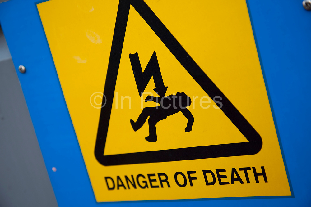 Warning sign says 'Danger of Death'.