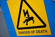Warning sign says 'Danger of Death'.