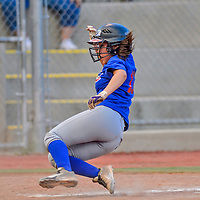 Pitcher Raykynne Billy slides into home base to score for the Cubs during a softball championship at Ford Canyon Park in Gallup.