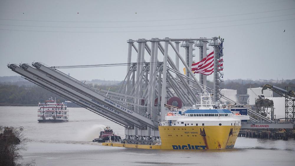 The deck cargo ship BigLift Barentsz sails up river past historic downtown Savannah to the Port of Savannah with three new Kone ship to shore cranes, Tuesday, Mar., 10, 2020, in Savannah, Ga. (GPA Photo/Stephen B. Morton)