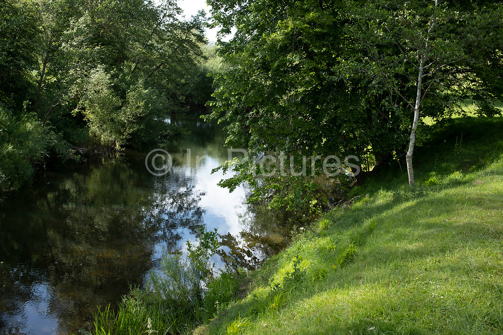 River Teme on 23rd May 2020 near Martley, United Kingdom. Martley is a village and civil parish in the Malvern Hills district of the English county of Worcestershire. The River Teme rises in Mid Wales, and flows through into England down to Shropshire and Worcestershire. The whole of the River Teme was designated as an SSSI, by English Nature, in 1996.