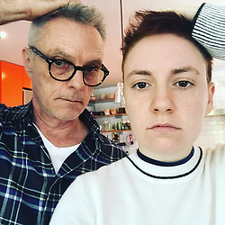 """Lena Dunham releases a photo on Instagram with the following caption: """"Finally reached utmost pinnacle of Daddy's Girl"""". Photo Credit: Instagram *** No USA Distribution *** For Editorial Use Only *** Not to be Published in Books or Photo Books ***  Please note: Fees charged by the agency are for the agency's services only, and do not, nor are they intended to, convey to the user any ownership of Copyright or License in the material. The agency does not claim any ownership including but not limited to Copyright or License in the attached material. By publishing this material you expressly agree to indemnify and to hold the agency and its directors, shareholders and employees harmless from any loss, claims, damages, demands, expenses (including legal fees), or any causes of action or allegation against the agency arising out of or connected in any way with publication of the material."""