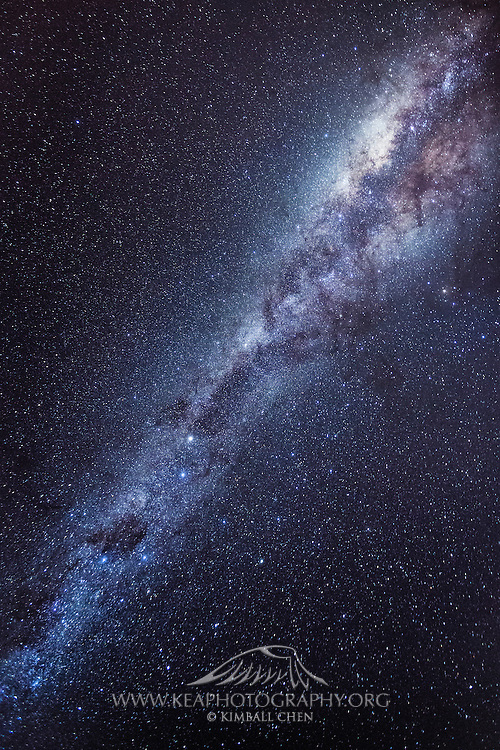 The glorious spiral arm of the Milky Way Galaxy stretches across the cloudless sky in Invercargill, New Zealand.