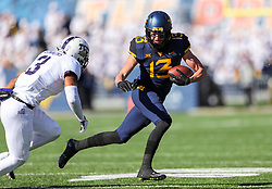 Nov 10, 2018; Morgantown, WV, USA; West Virginia Mountaineers wide receiver David Sills V (13) catches a pass and attempts to get past TCU Horned Frogs safety Markell Simmons (3) during the first quarter at Mountaineer Field at Milan Puskar Stadium. Mandatory Credit: Ben Queen-USA TODAY Sports