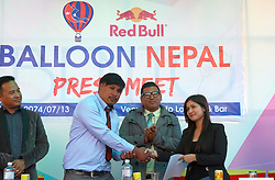 KATHMANDU, Oct. 30, 2017  Bikram Bade (2nd L), Chairman of Balloon Nepal shakes hands with Sambriddhi Ghimire (1st R) from Red Bull after exchanging documents to operate the ''Hot Air Balloon flights'' during a press conference held in Kathmandu, Nepal, on Oct. 30, 2017. (Credit Image: © Sunil Sharma/Xinhua via ZUMA Wire)