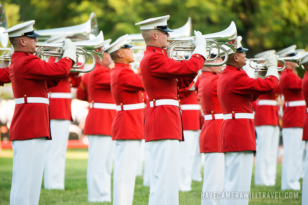 The United States Marine Drum and Bugle Corps, known as the Commandant's Own, performs at the Sunset Parade at the Iwo Jima Memorial in Arlington, Virginia, next to Arlington National Cemetery.