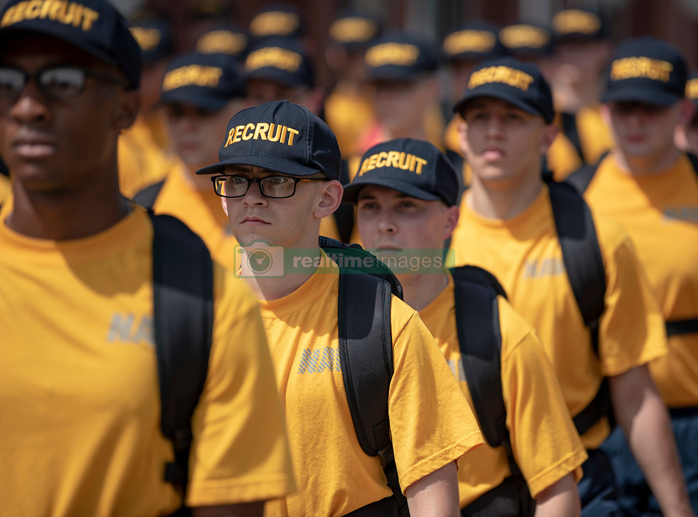 GREAT LAKES, Ill. (Aug. 15, 2018) Recruits stand at attention in formation after physical training at Recruit Training Command (RTC). More than 30,000 recruits graduate annually from the Navy's only boot camp. (U.S. Navy photos by Mass Communication Specialist 2nd Class Spencer Fling/Released)180815-N-PL946-1021