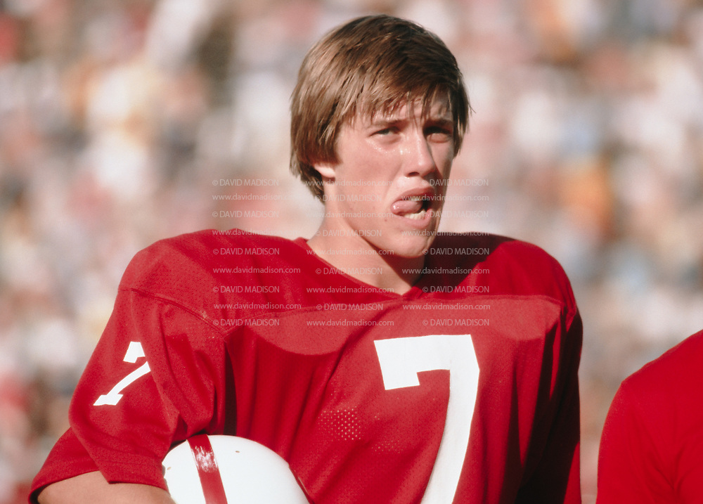 John Elway #7 of Stanford waits to be interviewed following  Stanford - Boston College game on September 29, 1979 at Stanford Stadium in Palo Alto, California.  Photograph by David Madison.