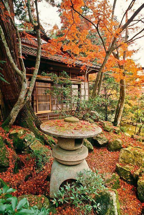 Stone lantern and teahouse in autumn, near Itsukushima shrine at Miyajima, Hiroshima Prefecture, Japan