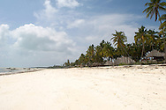 The beach at Jambiani with beachfront hotels built with African style thatched buildings. Zanzibar, Tanzania