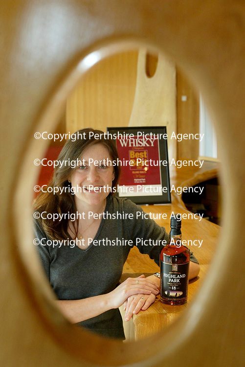 FREE TO USE PIC...Paula Hardie, Highland Park Global Marketing Manager with a bottle of 18 year old HP which has won the Best of the Best Island Malt award.<br />see press release form Alex Fitch/Edrington Group tel: 01738 493614<br />Picture by Graeme Hart<br />Perthshire Picture Agency<br />Tel: 01738 623350 / 07990 594431