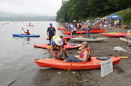 New Windsor, New York - An instructor slides a woman's kayak into the Hudson River at the Paddlefest event sponsored by the Mid-Hudson Chapter of the Adirondack Mountain Club at Kowawese Unique Area at Plum Point on  Sunday, June 13, 2010.