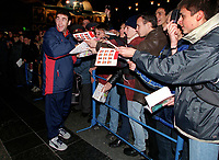 Arsenal defender Martin Keown signs autographs at Donetsk Airport as the team arrive for the Champions league match against Shakhtar Donetsk. Donetsk, Ukraine, 6/11/2000. Credit Colorsport / Stuart MacFarlane.