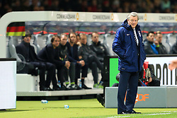 England Manager Roy Hodgson stands on the touch line as Germany Manager Joachim Low sits in dugout behind - Mandatory by-line: Matt McNulty/JMP - 26/03/2016 - FOOTBALL - Olympiastadion - Berlin, Germany - Germany v England - International Friendly