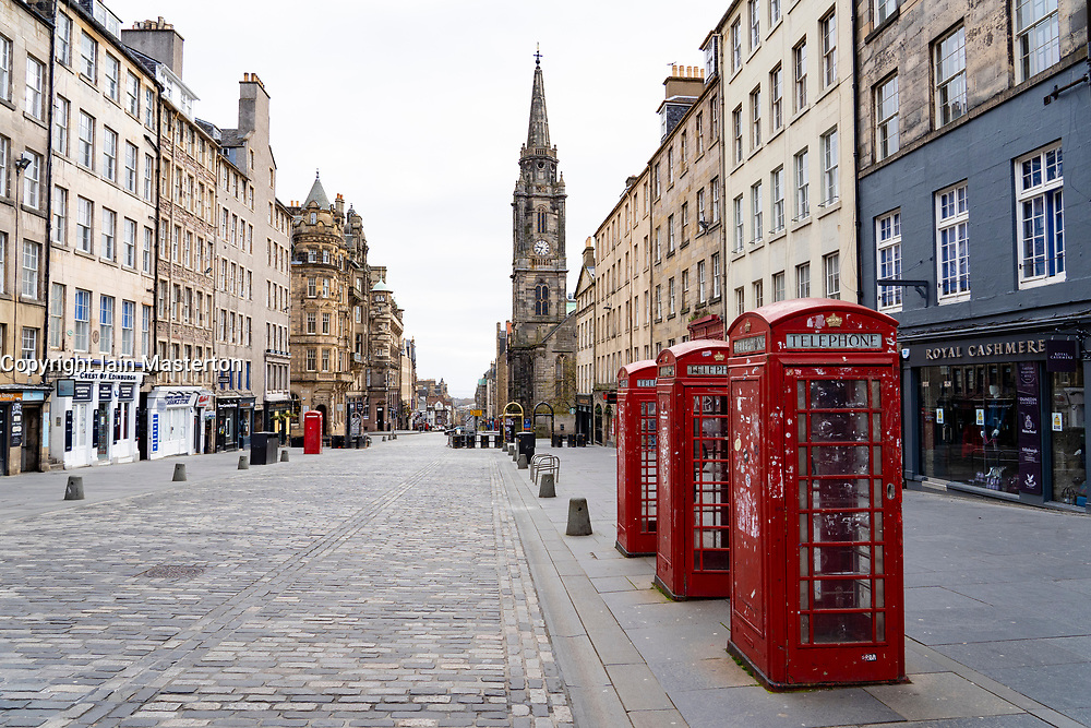 Edinburgh, Scotland, UK. 18 April 2020. Views of empty streets and members of the public outside on another Saturday during the coronavirus lockdown in Edinburgh. The Royal Mile is empty. Iain Masterton/Alamy Live News