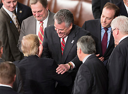 United States President Donald J. Trump is congratulated by Representative Peter King (R-NY) after addressing a joint session of Congress on Capitol Hill in Washington, DC, USA, February 28, 2017. Photo by Chris Kleponis/CNP/ABACAPRESS.COM