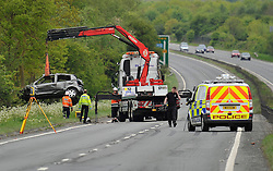 © Licensed to London News Pictures. 18th May  2013. A419 Swindon. 2 dead 3 injured in car crash at 5AM this morning on the Northbound A419 at Swindon. 18 year old female driver pronounced dead at the scene, 17 year old female front seat died at Great Western Hospital. Three male rear seat passengers were thrown from the car during the crash where the car barrel rolled down the embankment. Photo credit : MarkHemsworth/LNP