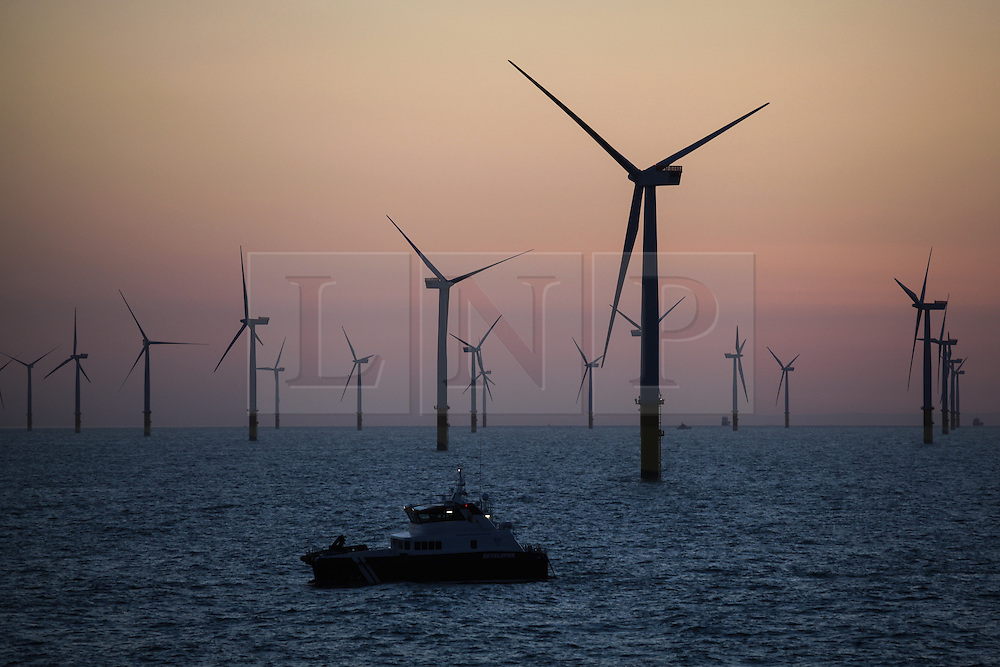 © Licensed to London News Pictures. 18/04/2014. North Wales, UK. A wind turbine transfer catamaran working at dawn on the Gwynt y Môr Offshore Wind Farm off the coast of North Wales this morning, Good Friday, 18th April 2014. Photo credit : Rob Arnold/LNP