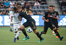 May 9, 2018 - Los Angeles, California, U.S - Walker Zimmerman #25 of the LAFC battles for the ball with Darwin Quintero #25 of the Minnesota United FC on Wednesday May 9, 2018, at the Banc of California Stadium in Los Angeles, California. LAFC defeats Minnesota United FC, 2-0. (Credit Image: © Prensa Internacional via ZUMA Wire)