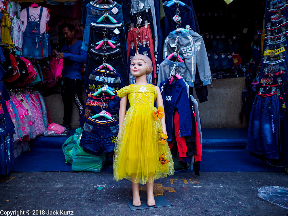 03 JULY 2018 - BANGKOK, THAILAND: A mannequin of a child wearing a yellow dress in Bobae Market. The birthday of King Maha Vajiralongkorn Bodindradebayavarangkun, Rama X, is 28 July. The King, the only son of Thailand's late King Bhumibol Adulyadej, became the King of Thailand in 2016 after the death of his father. King Vajiralongkorn was born on 28 July 1952, a Monday. In Thai culture each day of the week has a color, and yellow is the color is associated with Monday, so people wear yellow for the month before his birthday to honor His Majesty.      PHOTO BY JACK KURTZ