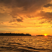The sun sets over Lake of the Woods, Ontario, Canada.